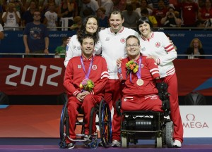 LONDON, ENGLAND 09/04/2012 Marco Dispaltro and Josh Vander Vies with (Coach) Cesar Nicolai, (Assistant) Karin Sterkenburg and (Assistant) Dalia Mykolaitiene receiving the Bronze Medal in the Boccia Mixed Pairs - BC4 at the London 2012 Paralympic Games at Excel. (Photo by Matthew Murnaghan/Canadian Paralympic Committee)